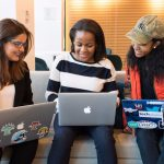 Women of color with laptops