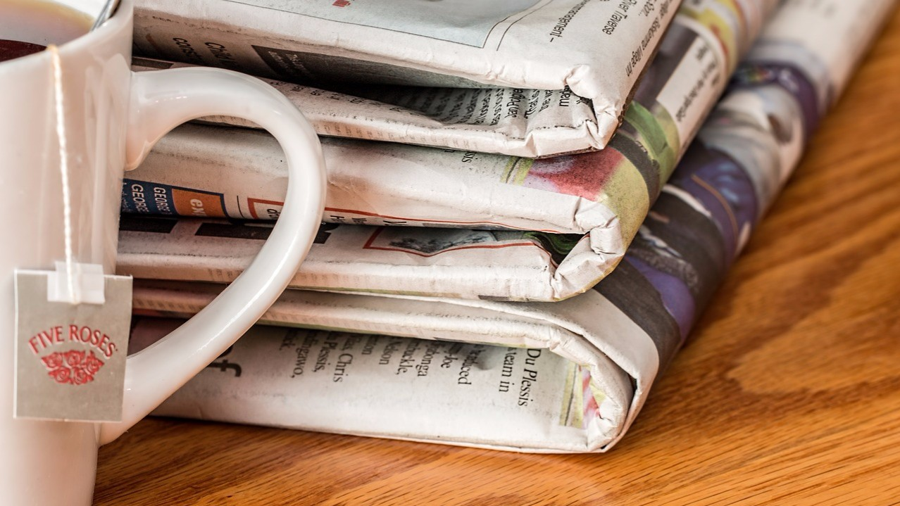 Newspapers and mug