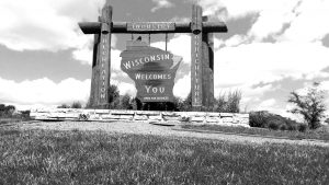 Wisconsin border sign in black and white