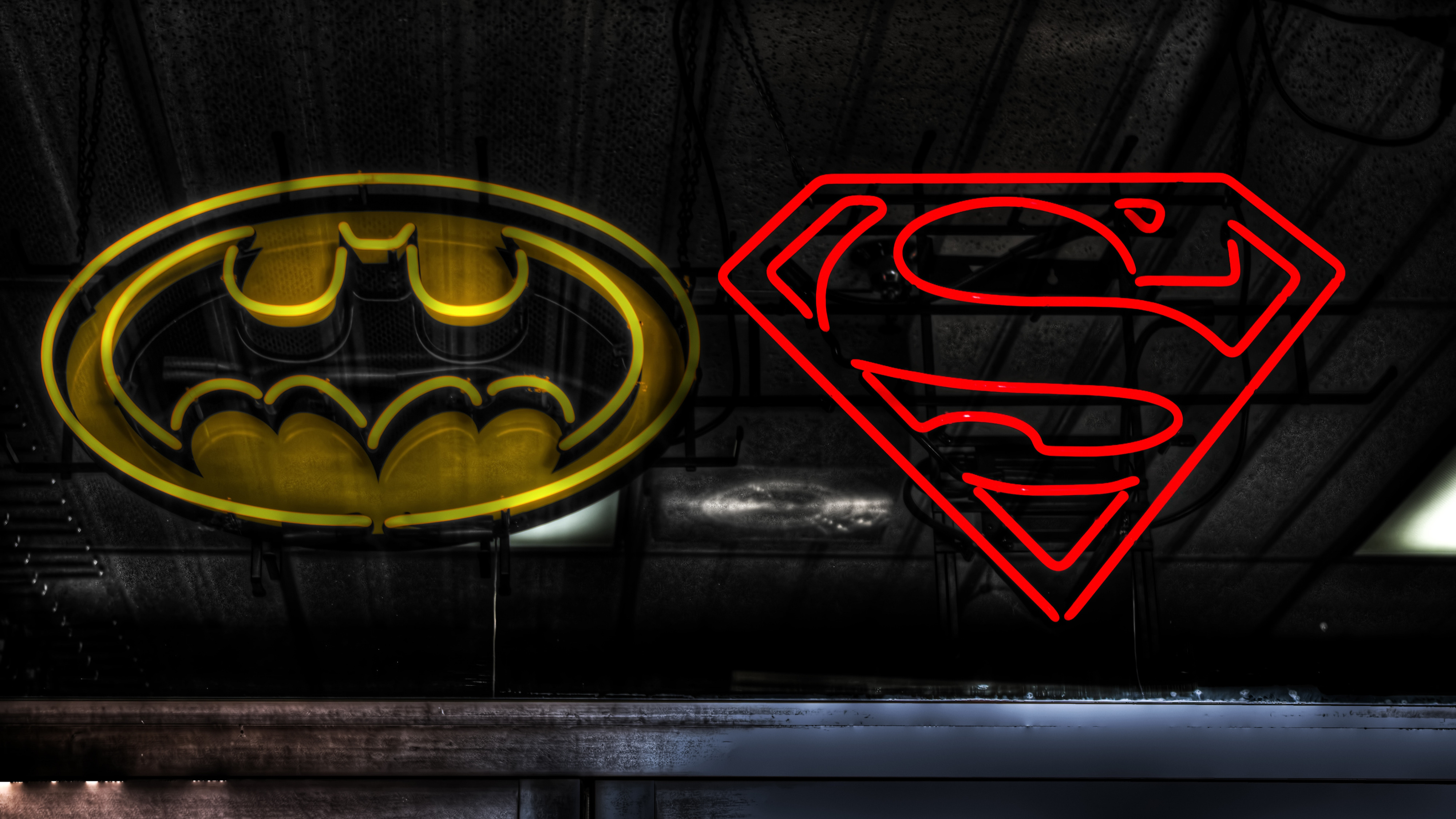 Superman and Batman logos