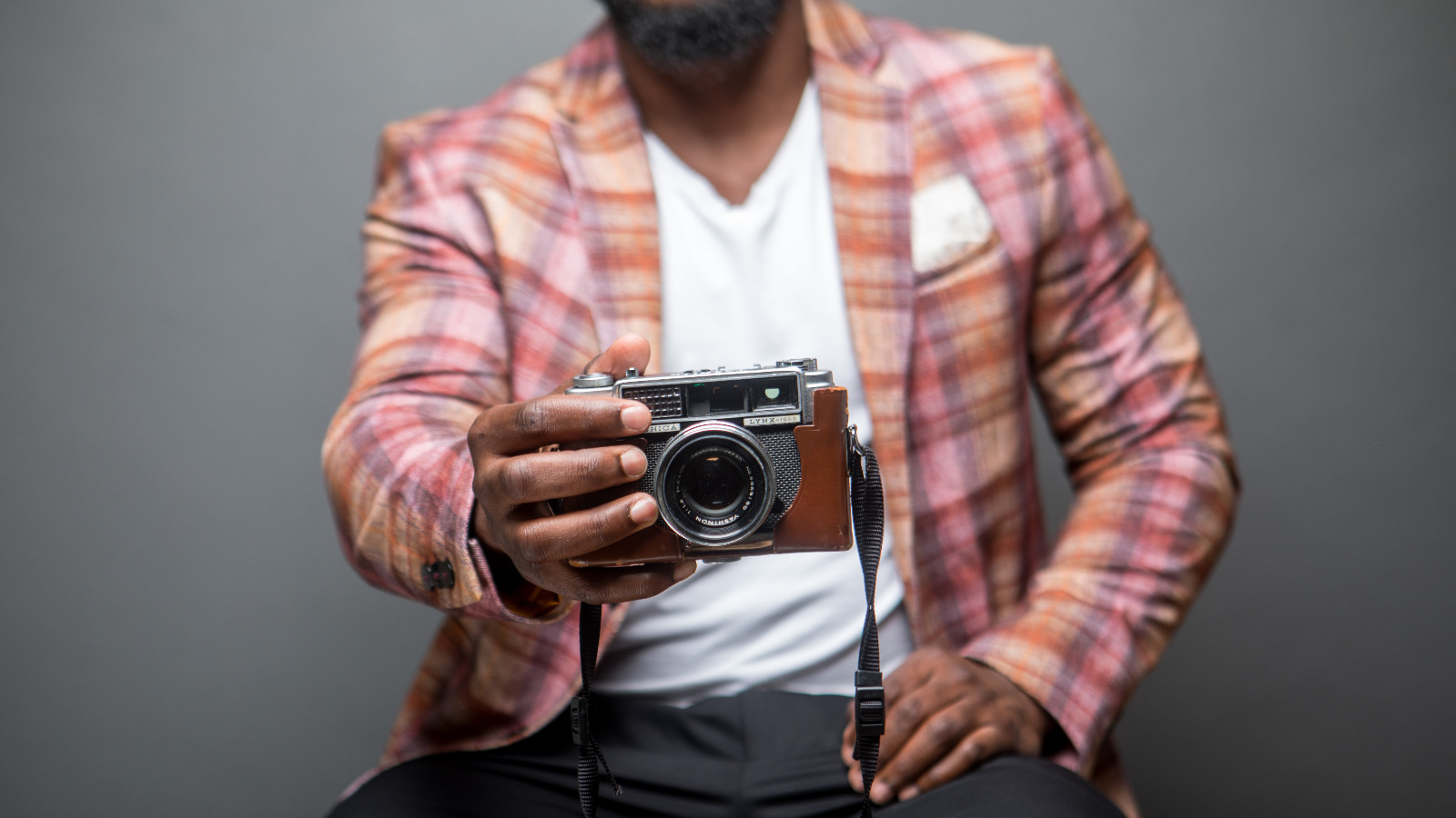 Man holding a camera.