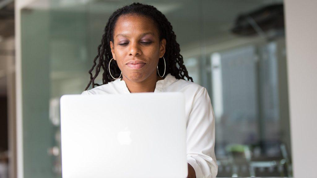 Black woman on a MacBook