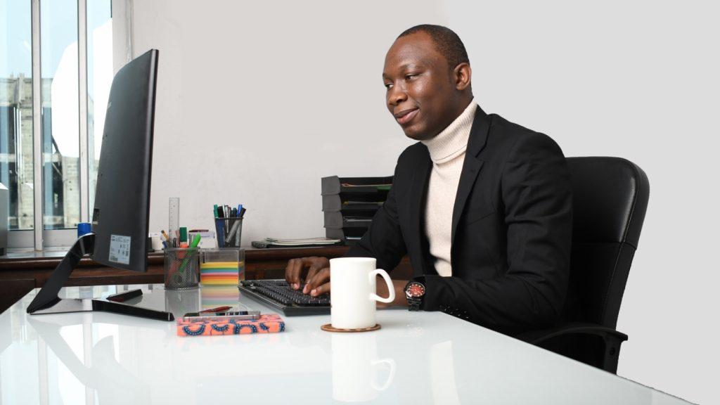 Black African man at desk