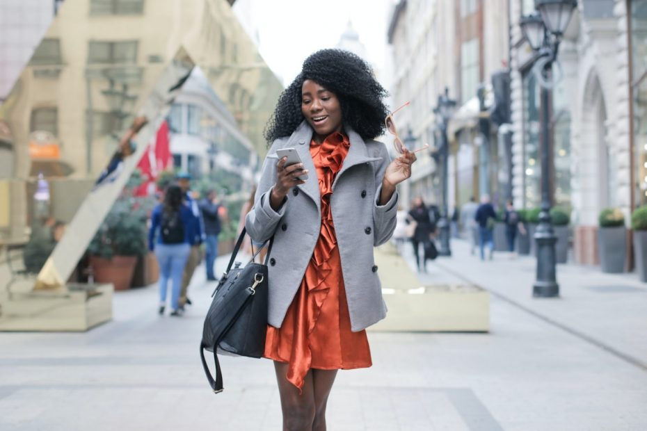 Woman with smartphone on street
