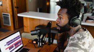 Black man recording podcast